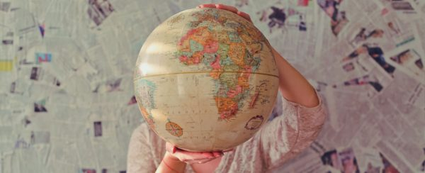 image of a woman holding a globe